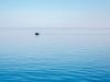 Small boat on a big lake