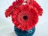 Red Gerberas in Black Vase